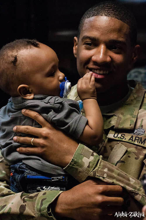 SPC Janeel Gumbs with 10 month old son Christopher.  Welcome home ceremony for the St. Thomas based soldiers of the 104th Troop.Command Rapid Aerostat Initial Deployment (RAID) Teamat the Cyril E. King.Airport.  VING's 104th RAID unit deployed to Afghanistan in support of Operation New Dawn. 2 September 2012.  © Aisha-Zakiya Boyd