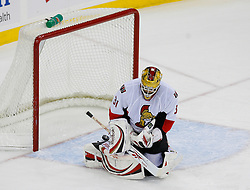 Jan 4, 2008; Newark, NJ, USA; Ottawa Senators goalie Alex Auld (31) makes a save during the third period at the Prudential Center. The Devils defeated the Senators 4-3 in overtime.