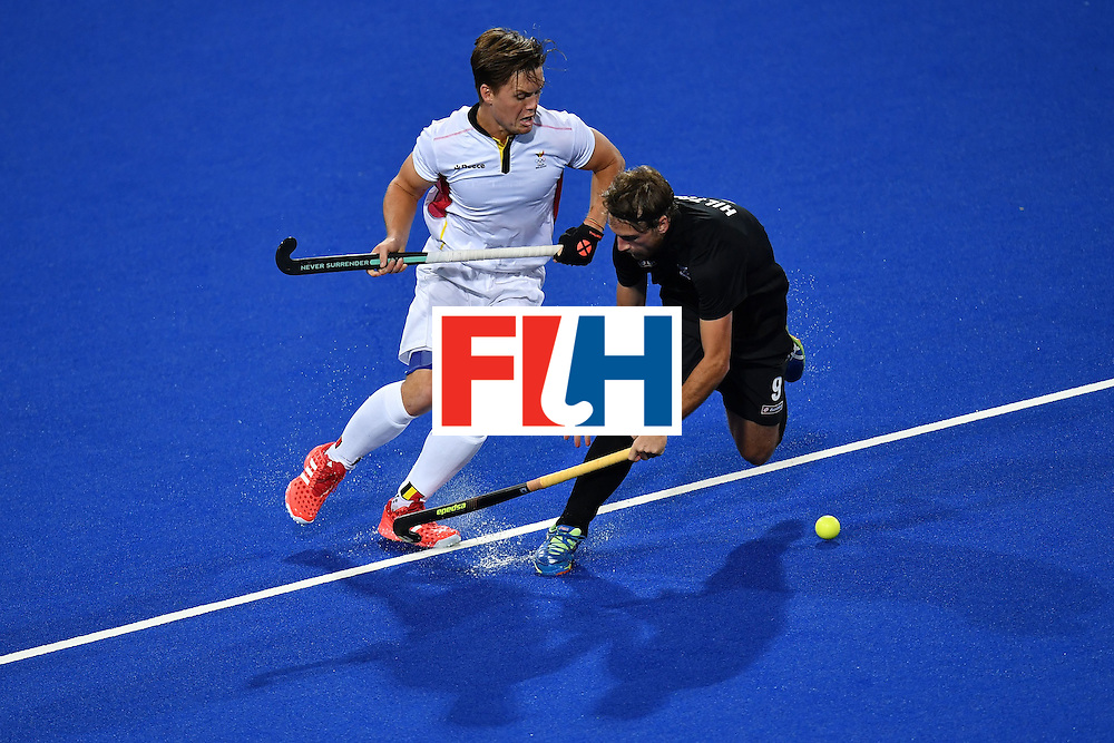 Belgium's Tom Boon (L) vies with New Zealand's Blair Hilton during the mens's field hockey Belgium vs New Zealand match of the Rio 2016 Olympics Games at the Olympic Hockey Centre in Rio de Janeiro on August, 12 2016. / AFP / MANAN VATSYAYANA        (Photo credit should read MANAN VATSYAYANA/AFP/Getty Images)