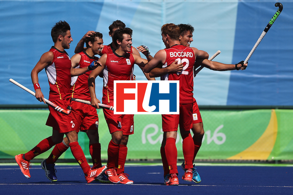 RIO DE JANEIRO, BRAZIL - AUGUST 06:  Florent van Aubel #8,  Gauthier Boccard #12, and Felix Denayer #19 of Belgium react to a goal during a Pool A match between Belgium and Great Britain on Day 1 of the Rio 2016 Olympic Games at the Olympic Hockey Centre on August 6, 2016 in Rio de Janeiro, Brazil.  (Photo by Sean M. Haffey/Getty Images)