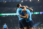 Giovanbattista Venditti (Italy's winger) celebrating with team mates after scoring Italy's first try of the rugby world cup during the Rugby World Cup Pool D match between France and Italy at Twickenham, Richmond, United Kingdom on 19 September 2015. Photo by Matthew Redman.