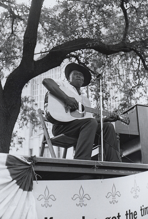 Blues Singer Robert 'Pate' Williams plays guitar at the second Louisiana Jazz and Heritage festival in Congo Square in New Orleans in 1971.