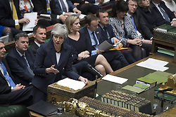 March 27, 2019 -  London, England, United Kingdom - British Prime Minister THERESA MAY (front) speaks during the Prime Minister's Questions in the House of Commons. British lawmakers on Wednesday overwhelmingly voted to change original Brexit departure date in law to April 12 or May 22 as British Prime Minister Theresa May was in an 11 hour appeal to Tory MPs to back her Withdrawal Agreement. (Credit Image: © Uk Parliament/Jessica Taylor/Xinhua via ZUMA Wire)