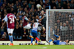Robert Green of QPR collides with Gabriel Agbonlahor of Aston Villa as he makes a save - Photo mandatory by-line: Rogan Thomson/JMP - 07966 386802 - 07/04/2015 - SPORT - FOOTBALL - Birmingham, England - Villa Park - Aston Villa v Queens Park Rangers - Barclays Premier League.
