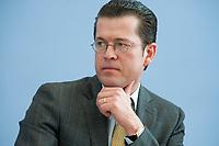 12 APR 2010, BERLIN/GERMANY:<br /> Karl-Theodor zu Guttenberg, CDU, Bundesverteidigungsminister, waehrend einer Pressekonferenz zur Vorstellung der Strukturkommission der Bundeswehr, Bundespressekonferenz<br /> IMAGE: 20100412-01-023