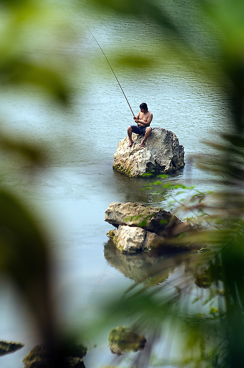 A fisherman on the Nam Khan (river), Laos.