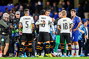 Valencia CF forward Rodrigo (19) celebrates with his team mates at full time during the Champions League match between Chelsea and Valencia CF at Stamford Bridge, London, England on 17 September 2019.