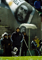 ARGENTINA win over URUGUAY at a soccer match, and its qualify for the FIFA World Cup  South Africa 2010 <br /> October 12, 2009<br /> Argentine head coach DIEGO MARADONA and a pitcher from el CHE GUEVARA at his back during the match.<br /> © PikoPress