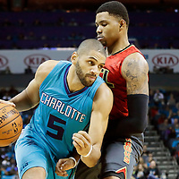 01 November 2015: Charlotte Hornets forward Nicolas Batum (5) drives past Atlanta Hawks guard Kent Bazemore (24) during the Atlanta Hawks 94-92 victory over the Charlotte Hornets, at the Time Warner Cable Arena, in Charlotte, North Carolina, USA.