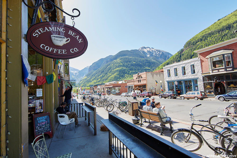 Colorado Avenue is lined with bicycles as locals get coffee and begin their summer day in Telluride.