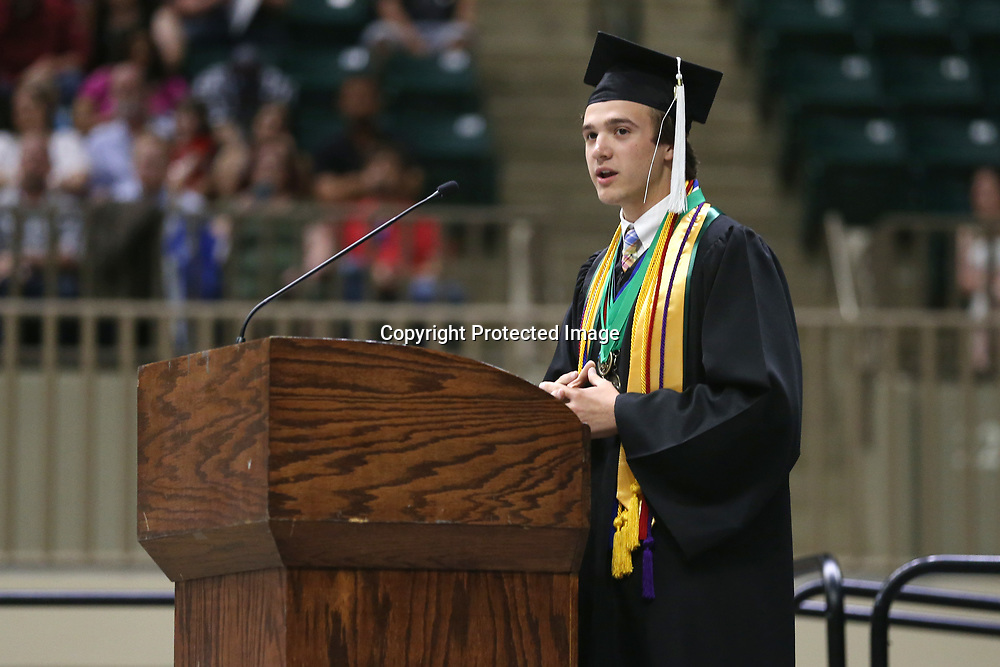 Mooreville High School salutatorian Chase Patterson delivers his salutatorian speech to the crowd gathered for Mooreville's graduation ceremony Saturday afternoon at the BancorpSouth Arena.