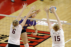 24 November 2006: Anne Teegardin strikes towards and is blocked by Shandra Harper during a Quarterfinal match between the Evansville University Purple Aces and the Missouri State University Bears.The Tournament was held at Redbird Arena on the campus of Illinois State University in Normal Illinois.<br />