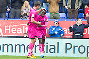 Rochdale forward Fabio Tavares celebrates his goal with team-mate to make it 3-1 during the EFL Sky Bet League 1 match between Bolton Wanderers and Rochdale at the University of  Bolton Stadium, Bolton, England on 19 October 2019.