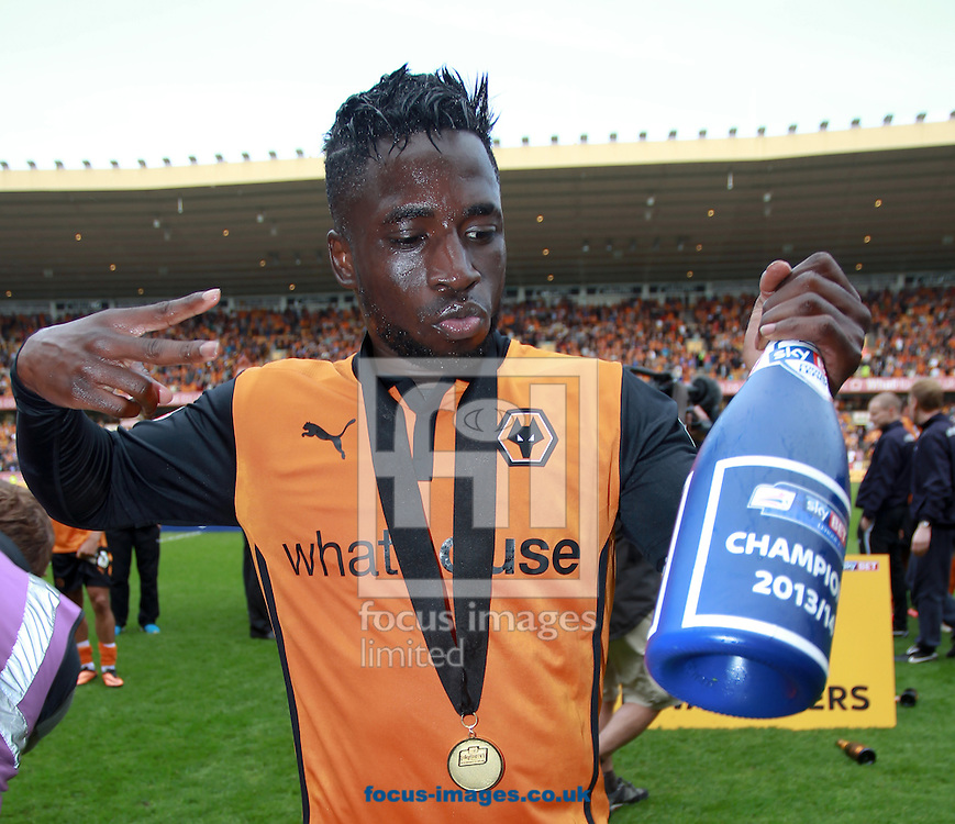 Nouha Dicko of Wolverhampton Wanderers celebrates winning the Sky Bet League 1 title at Molineux, Wolverhampton<br /> Picture by John Rainford/Focus Images Ltd +44 7506 538356<br /> 03/05/2014