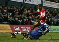 Photo: Paul Thomas.<br /> Oldham Athletic v Swindon Town. Coca Cola League 1.<br /> 10/12/2005.<br /> <br /> Swondon's Rickyl Shakes gets tackled by Terrell Forbes.