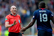 Referee Bobby Madden speaks to Uche Ikpeazu (#19) of Heart of Midlothian during the Ladbrokes Scottish Premiership match between Motherwell and Heart of Midlothian at Fir Park, Motherwell, Scotland on 15 September 2018.