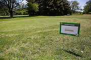 Alumni golf outing sponsor signs. Photo by Lauren Pond