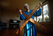 Paula Douthett of the Sacred Dance Group holds a large cross at the christian friends' home in Dorset