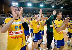 Milan Mirkovic, Rok Praznik, Matjaz Brumen  and team of Cimos at MIK First league Handball match between RK Cimos Koper and RD Slovan, on May 9, 2009, in SRC Bonifika, Koper, Slovenia.  (Photo by Vid Ponikvar / Sportida)