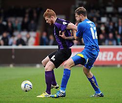 Bristol Rovers' Matt Harrold holds the ball up from AFC Wimbledon's Harry Pell - Photo mandatory by-line: Dougie Allward/JMP - Mobile: 07966 386802 05/04/2014 - SPORT - FOOTBALL - Kingston upon Thames - Kingsmeadow - AFC Wimbledon v Bristol Rovers - Sky Bet League Two