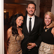 Heather Fisher, left, David Fisher, center, and Eliza Everhardt pose for a picture Saturday December 6, 2014 during the 9th Annual Wilmington Fur Ball at the Country Club of Landfall in Wilmington, N.C. (Jason A. Frizzelle)