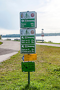 Direction signs on a bicycle path. Photographed on the Danube River, Austria
