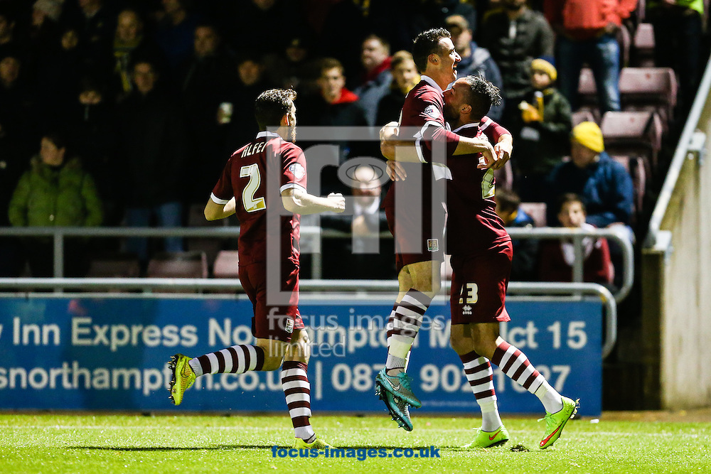 Enda Stevens of Northampton Town (centre) celebrates after scoring their first goal during the Sky Bet League 2 match at Sixfields Stadium, Northampton<br /> Picture by Andy Kearns/Focus Images Ltd 0781 864 4264<br /> 21/10/2014