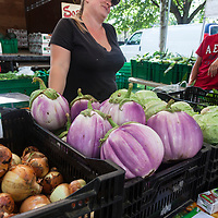 Farmer Jessie Sosnicki with her Lolla Rosa heirloom eggplant at Dufferin Grove Organic Farmers Market in Toronto.