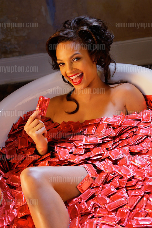 Dept of Health 'Condom Essential Wear' campaign with Alesha Dixon.PRESS ASSOCIATION Photo. Picture date: Monday, 11th February 2008. .'Condom Essential Wear' is the Department of Health's safer sex campaign, which aims to normalise condom use and highlight the consequences of unprotected sex Valentines The Condom Essential Wear campaign is being spearheaded by Alesha Dixon who will highlight the importance of condom use over this period . .Photo credit should read: Anthony Upton/PA Wire