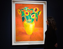 Christie's, London, March 3rd 2017. PICTURED: A woman admires David Hockney's 'Sunflowers In A Yellow Vase', painted in 1996, which is expected to fetch between £1.5-2.5 million.<br /> Fine art auctioneers Christies hold a press preview for their Post-War and Contemporary Art auctions to be held on March 7th and 8th.