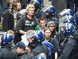 © Licensed to London News Pictures . 11/06/2013 . London , UK . Police lead away people from inside after cutting their way in with an angle grinder . Police surround a former police station on 40 Beak Street , Soho this morning (11th June) . The site has been occupied by organisers of today's Stop G8 anti capitalist protests . Demonstrations in London today (Tuesday 11th June 2013) ahead of Britain hosting the 39th G8 summit on 17th/18th June at the Lough Erne Resort , County Fermanagh , Northern Ireland , next week . Photo credit : Joel Goodman/LNP