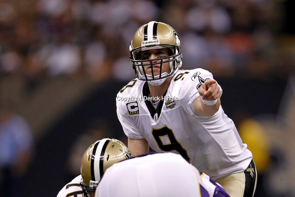 September 9, 2010; New Orleans, LA, USA; New Orleans Saints quarterback Drew Brees (9) under center against the Minnesota Vikings during the NFL Kickoff season opener at the Louisiana Superdome. The New Orleans Saints defeated the Minnesota Vikings 14-9.  Mandatory Credit: Derick E. Hingle