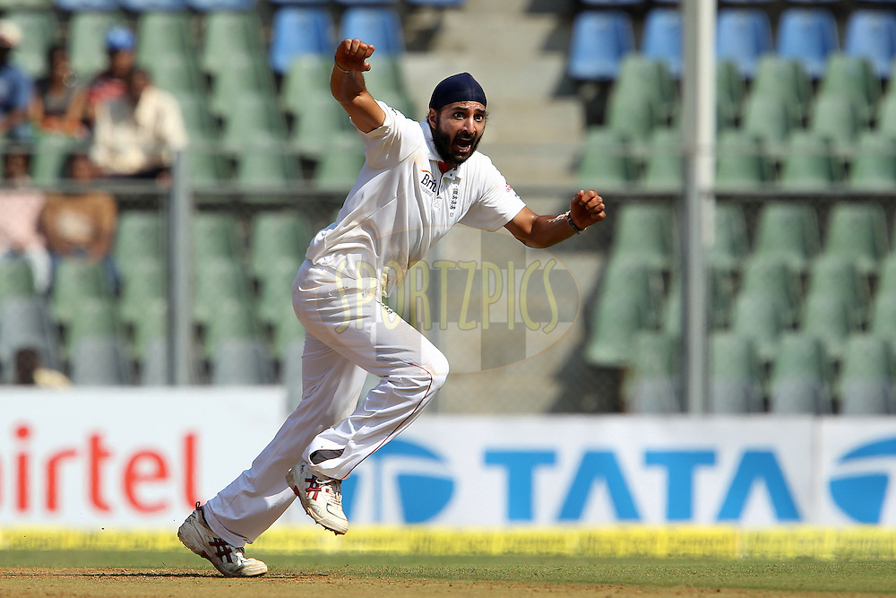 Monty Panesar of England celebrates the wicket of Sachin Tendulkar of India during day 1 of the 2nd Airtel Test match between India and England held at the Wankhede Stadium in Mumbai, India on the 23rd November 2012...Photo by Ron Gaunt/ BCCI/ SPORTZPICS..Use of this image is subject to the terms and conditions as outlined by the BCCI. These terms can be found by following this link:..http://www.sportzpics.co.za/image/I0000SoRagM2cIEc