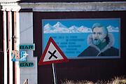 Crossroads sign Barentsburg, with mural and signs for the now closed 78 Bar. Barentsburg is a Russian coal mining town in the Norwegian Archipelego of Svalbard. Once home to about 2000 miners and their families, less than 500 people now live here.