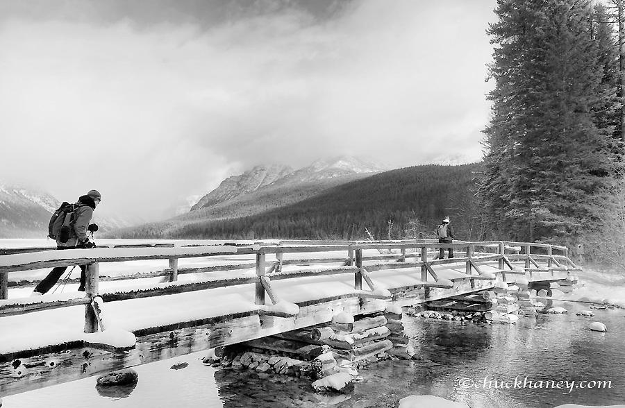 Couple ski touring to Bowman Lake in Glacier National Park, Montana, USA MR