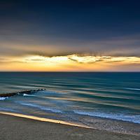 Conceptual beach scene with jetty
