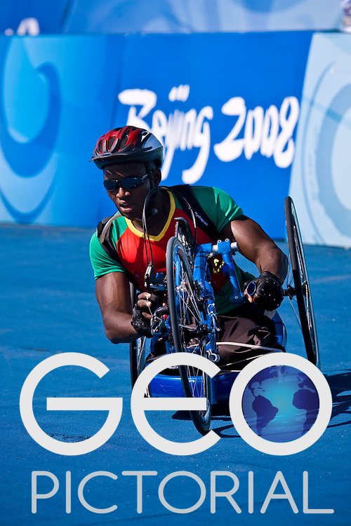 BEIJING, SEPTEMBER 12: GASBEOGO Lassane of Burkina Faso in the Men's Road Cycling Road Race Handcycling (HC A) at the Triathlon Venue during day six of the 2008 Paralympic Games on September 12, 2008 in Beijing, China.