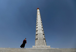 A North Korean guide stands next to the Tower of the Juche Ider in Pyongyang, North Korea, 12 April 2017. North Koreans prepare to celebrate the 'Day of the Sun Festival', 105th birthday anniversary of former North Korean supreme leader Kim Il-sung in Pyongyang on 15 April.