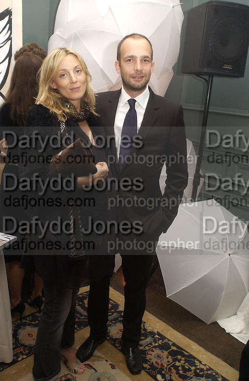 Phoebe Philo and Max Wigram, The Vogue List, celebrated by Vogue and Motorola. 33 Portland Place. 3 November 2004. ONE TIME USE ONLY - DO NOT ARCHIVE  © Copyright Photograph by Dafydd Jones 66 Stockwell Park Rd. London SW9 0DA Tel 020 7733 0108 www.dafjones.com
