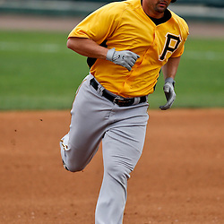 Mar 1, 2013; Sarasota, FL, USA; Pittsburgh Pirates first baseman Gaby Sanchez (14) hits a solo homerun against the Baltimore Orioles during the top of the fourth inning of a spring training game at Ed Smith Stadium. Mandatory Credit: Derick E. Hingle-USA TODAY Sports