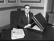 Minister for Finance, Gene Fitzgerald.  (N59)..1981..28.01.1981..01.28.1981..28th January 1981..Minister for Finance, Gene Fitzgerald,is seen preparing for the delivery of his budget to Dáil Éireann..Images show the Minister with the trade mark case which contains the budget. The minister displays the edition of the Cork Examiner which makes comment on the forthcoming budget.