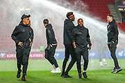 England players scatter when the sprinkler on the pitch goes off ahead of the UEFA European 2020 Qualifier match between Czech Republic and England at Sinobo Stadium, Prague, Czech Republic on 11 October 2019.