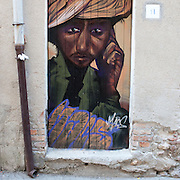 Riace, Calabria, Italia, aug. 2010. Refugees received in Riace. Riace il paese che accoglie rifugiati. A murales.