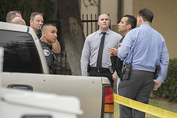 August 15, 2017 - Fullerton, CA, USA - Investigators talk in front of an apartment building during a murder investigation where a man in his 30s stabbed his mother and her boyfriend in Fullerton, CA on Tuesday morning, August 15, 2017. (Credit Image: © Ken Steinhardt/The Orange County Register via ZUMA Wire)