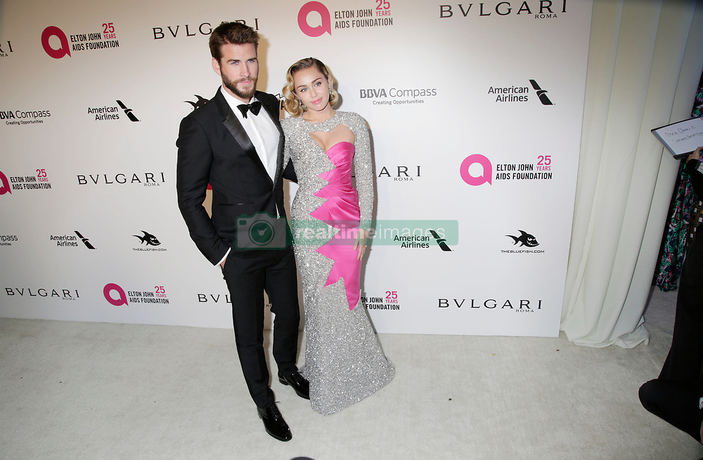 Liam Hemsworth and Miley Cyrus arriving at the Elton John Oscar Party held in Beverly Hills, Los Angeles, USA.