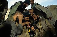 Afghanistan. Helmand province. Japanese technology comes to the resistance. Cameras and video equipment are increasingly used by mujahidin.  Kandahar area  Afghanistan     /  Depuis quelques années, la technique japonaise a fait irruption dans les maquis. Appareils photos et vidéo sont couramment utilisés par les moudjahidines.  Kandahar region  Afghanistan