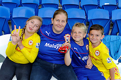 A family of Cardiff City fans - Photo mandatory by-line: Dougie Allward/JMP - Mobile: 07966 386802 19/08/2014 - SPORT - FOOTBALL - Cardiff - Cardiff City Stadium - Cardiff City v Wigan Athletic - Sky Bet Championship