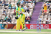Smith is congratulated by Coulter-Nile on reaching 100 during the ICC Cricket World Cup 2019 warm up match between England and Australia at the Ageas Bowl, Southampton, United Kingdom on 25 May 2019.