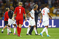 Football - European Championships 2012 - England vs. Italy<br /> Roy Hodgson, England manager consoles Ashley Cole at the Olympic Stadium, Kiev