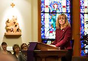 Professor Brenda Senger addresses new BSN-prepared nurses in 2013 as the student-chosen faculty speaker. (Photo by Ryan Sullivan)